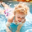 Stock Photo: Little blondie girl in swimming pool