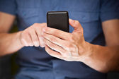 Close up of a man using mobile smart phone — Foto Stock