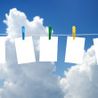 Blank photos hanging on a clothesline, blue sky on background — ストック写真