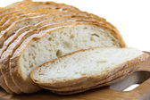 Sliced white loaf on the board — Stock Photo