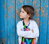 Outdoor portrait of angry little girl — Stock Photo