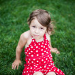 Stock Photo: Little girl lying on green grass