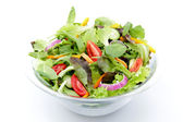 Mixed salad on white background — Stock Photo