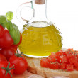 Typical mediterranefood whit bread garlic tomato end basil — Stock Photo #11814055