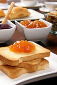 Toasted with marmalade on the brown table — Stock Photo