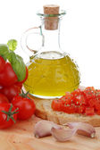 Typical mediterranean food whit bread garlic tomato end basil — Stock Photo