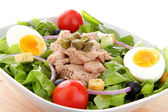 Mixed salad with tuna fish, eggs, onion and tomatoes — Stock Photo