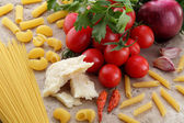 Pasta spaghetti macaroni tomato onion parmesan — Stock Photo