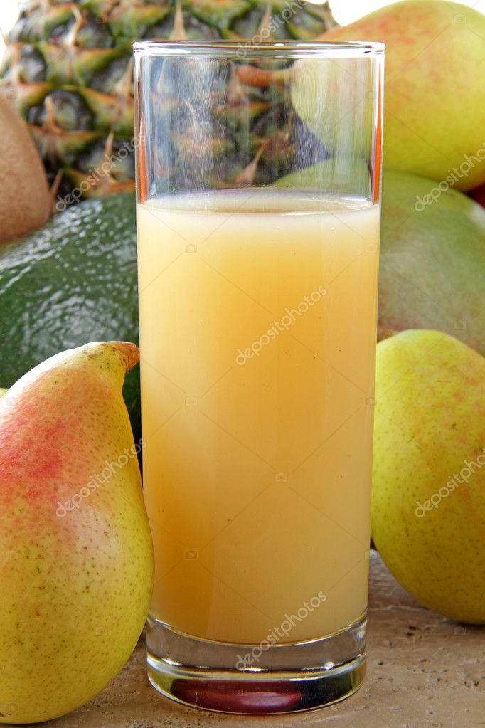 Fresh pear juice in the glass on the table — Stock Photo #11828536