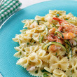 Butterfly pasta, shrimps and zucchini — Stock Photo