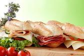 Sandwick with salami bacon cheese tomato — Stock Photo