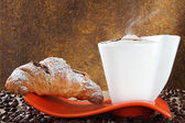 Cappuccino and croissant — Stock Photo