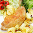 Isolated roast chicken and  potatoes on the plate — Stock Photo
