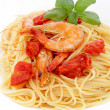 图库照片: Spaghetti with prawns on white background