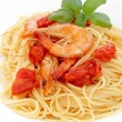 Foto Stock: Spaghetti with prawns on white background