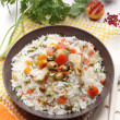 Rice salad  with vegetables in oliveoil — Stock Photo