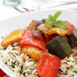 Wild Rice  with vegetables in tomato sausages — Stock Photo