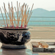 Burning incense sticks in bowl — Stock Photo