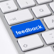 "Keyboard with one blue button with the word ""feedback"" - Stock Photo"