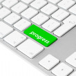 Computer keyboard with green progress button - Stock Photo