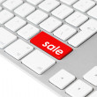 Computer keyboard with red sale button - Stock Photo