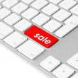 Computer keyboard with red sale button — Stock Photo