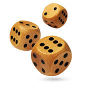 Three rolling wooden dices isolated on white — Stock Photo