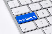 """Keyboard with one blue button with the word """"feedback"""" — Stock Photo"""
