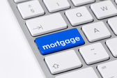 Keyboard with one blue button with the word mortgage — Stock Photo