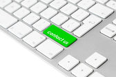 Computer keyboard with green contact us button — Stock Photo