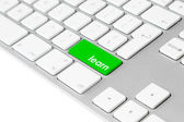 Computer keyboard with green learn button — Stock Photo