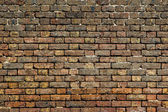 Dirty old red brick wall background front view — Stock Photo