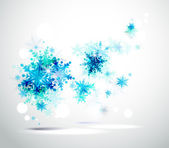 Christmas background with abstract winter blue snowflakes — Stock Vector
