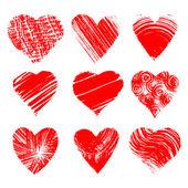 Set of nine artistic hearts — Stock Vector