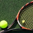Постер, плакат: Tennis racket with a ball