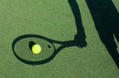 Shadow of a tennis player — Stock Photo
