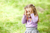 Little girl is playing hide-and-seek open face — Stock Photo