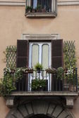 Flowers on a european balcony — Stock Photo