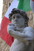 Detail of statue of David with italian flag, by Michelangelo, Florence, Italy — Stock Photo