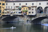 Ponte Vecchio Bridge with kayaker, Florence, Italy — Stock Photo