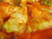 Cabbage rolls in sauce close-up — Stock Photo
