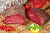 Italian bresaola with tomatoes — Stock Photo
