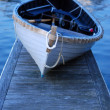 Blue Dinghy on the Dock — Stock Photo