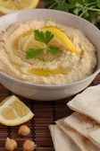 Hummus with pitta bread — Stock Photo