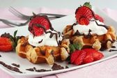 Waffles with strawberries and cream — Stock Photo