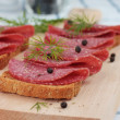 Salami slices — Stock Photo