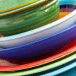 Colourful bowls and plates — Stock Photo