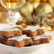 Star-shaped Christmas cinnamon cookies and a glass of wine or sherry - Stock Photo
