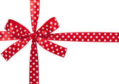 Red ribbon with bow on white — Stock Photo