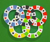 Five colorful types of poker chips olympic circles isolated on poker table background — Stockfoto